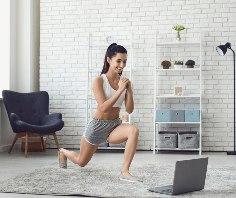 create a home workout space. woman exercising watching laptop